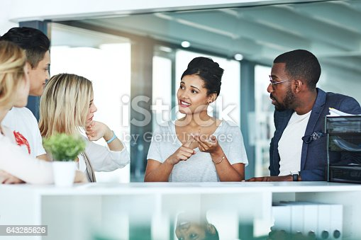 Shot of a group of colleagues having a discussion at work