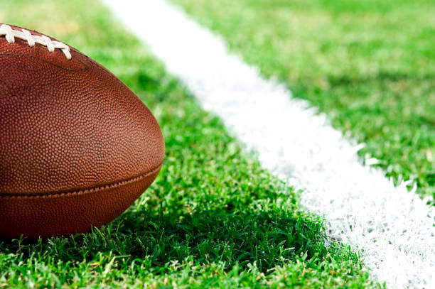 first and goal, ball at goal line - american football - close to stock photos and pictures