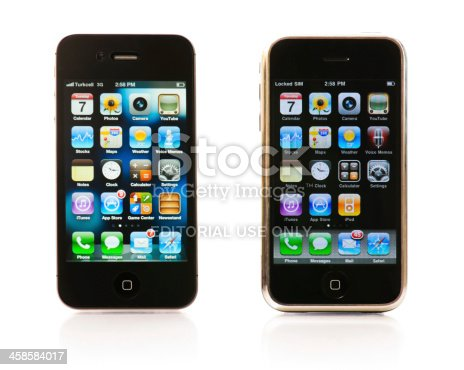 Istanbul, Turkey - February 07, 2012: The front wiews of an iPhone 4S and an iPhone 2G isolated on white background. iPhone is a smart cellular phone produced by Apple Computer Inc.