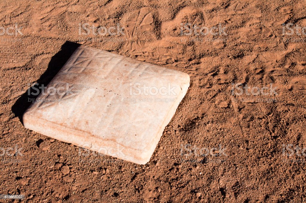First base in the dirt on a baseball diamond stock photo