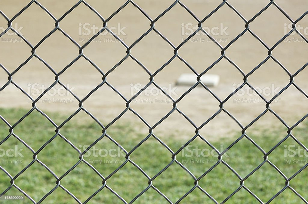 First Base on Baseball Field Through Fence royalty-free stock photo