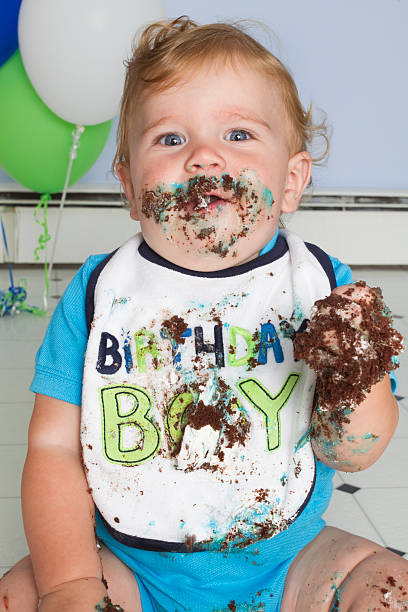 first birthday cake baby boy on first birthday after he indulges in cake first birthday stock pictures, royalty-free photos & images