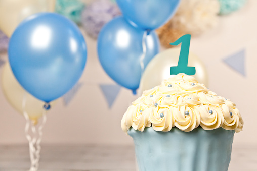 istock First Birthday Giant Blue and Cream Cup Cake 464808196