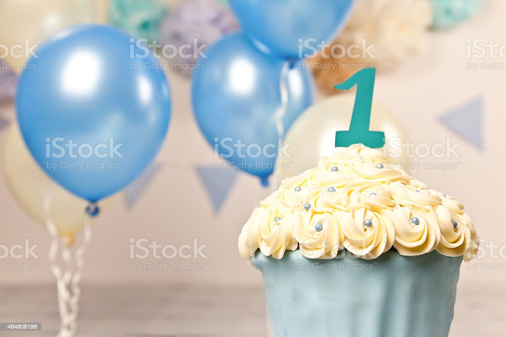 First Birthday Giant Blue and Cream Cup Cake stock photo