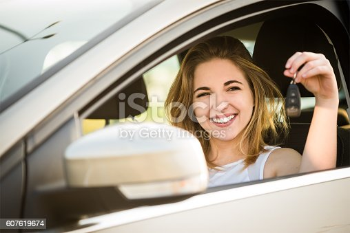 607592606 istock photo First car - young woman with keys 607619674