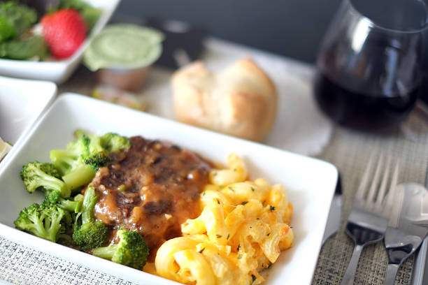 first class airline meal - gemaksvoedsel stockfoto's en -beelden