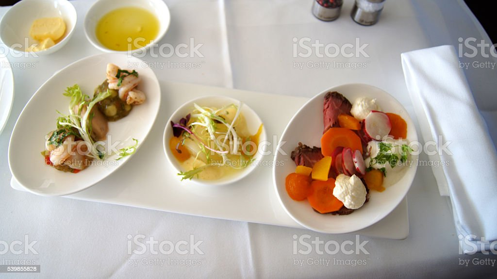 SEPTEMBER 2014: First Class Dining onboard an Boeing 747 stock photo