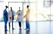 Blurred shot of a team of doctors standing together in a hospital