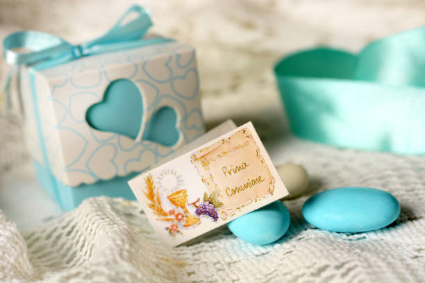 First communion bonbonniere with ribbons - foto stock