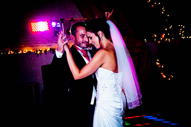 First dance of bride and groom with a pink hue stock photo