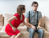 istock First date concept. Young woman is flirting with shy man. 623867616