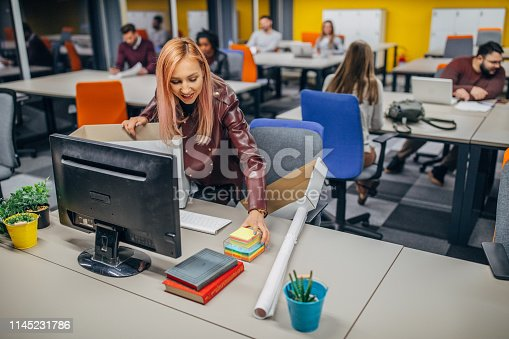 Multi-ethnic group of people, millenials working in big modern office all together, one woman is first day at work.