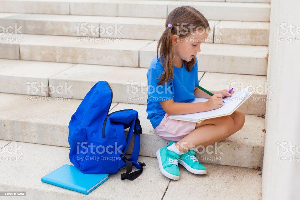 First day of school. Concept back to school. child girl schoolgirl...