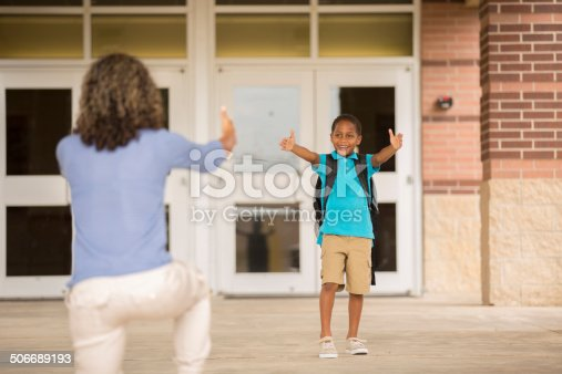 istock First day of school.  Little boy reaches out to mom. 506689193