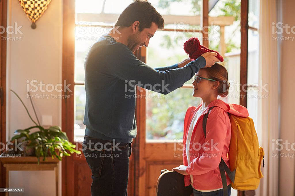 First day of school, saying goodbye at the door. stock photo