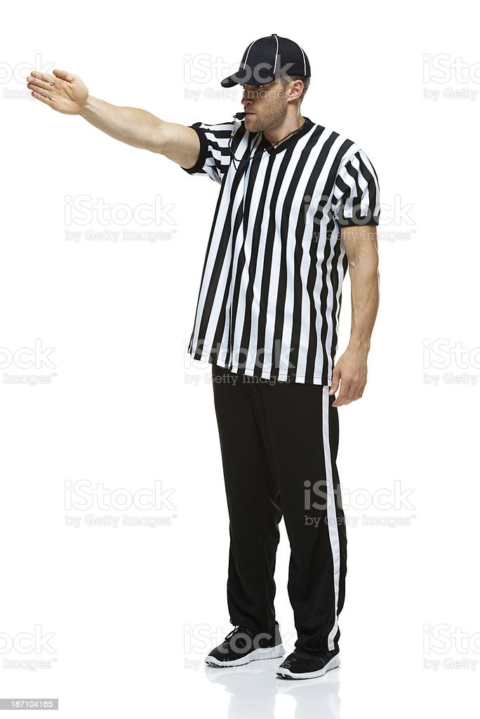 First down - American football referee using whistle royalty-free stock photo