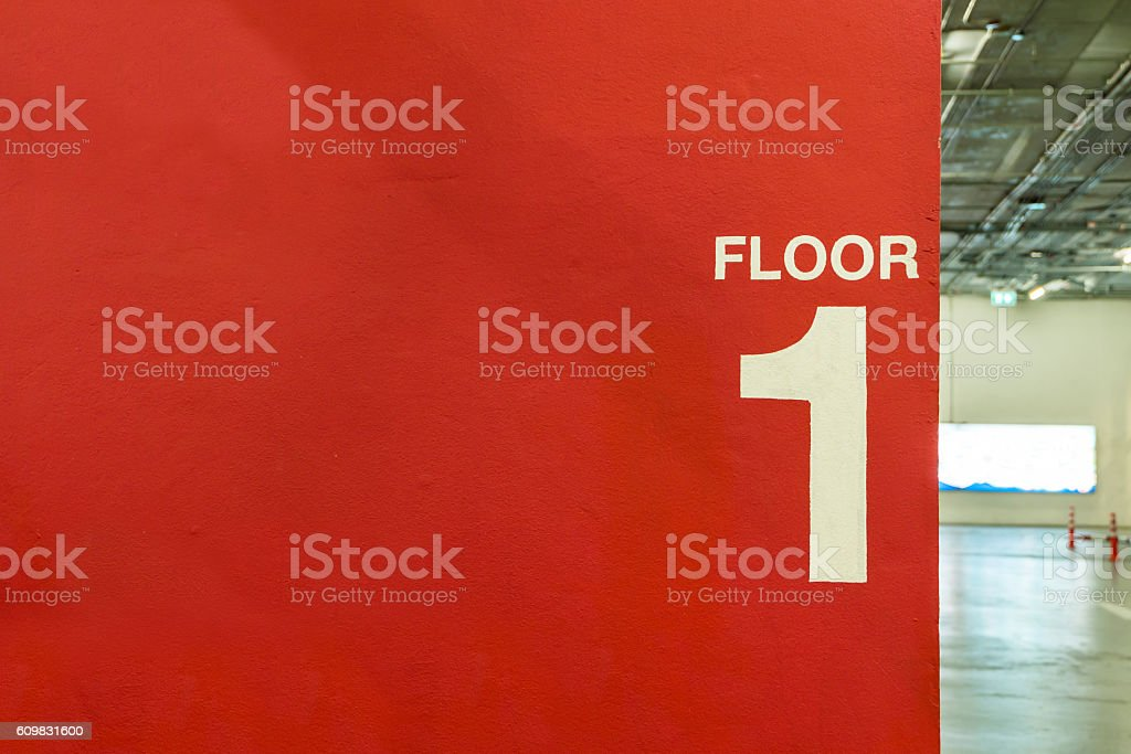 First floor painted on wall at parking, copy space stock photo