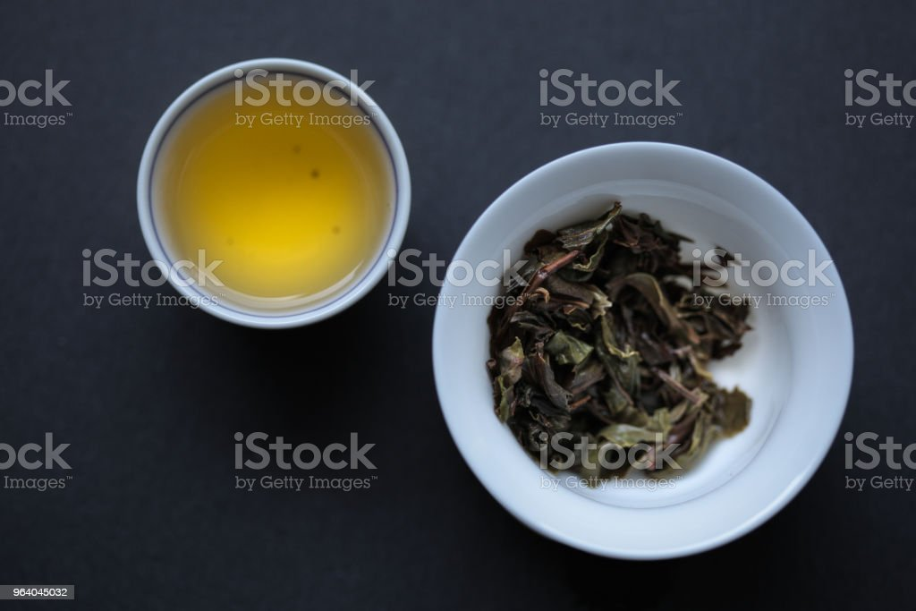 First Flush Ghaan, liquor and steeped leaves - Royalty-free Dried Tea Leaves Stock Photo