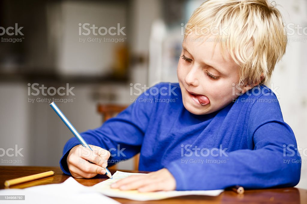 First grader tries his hand at drawing stock photo