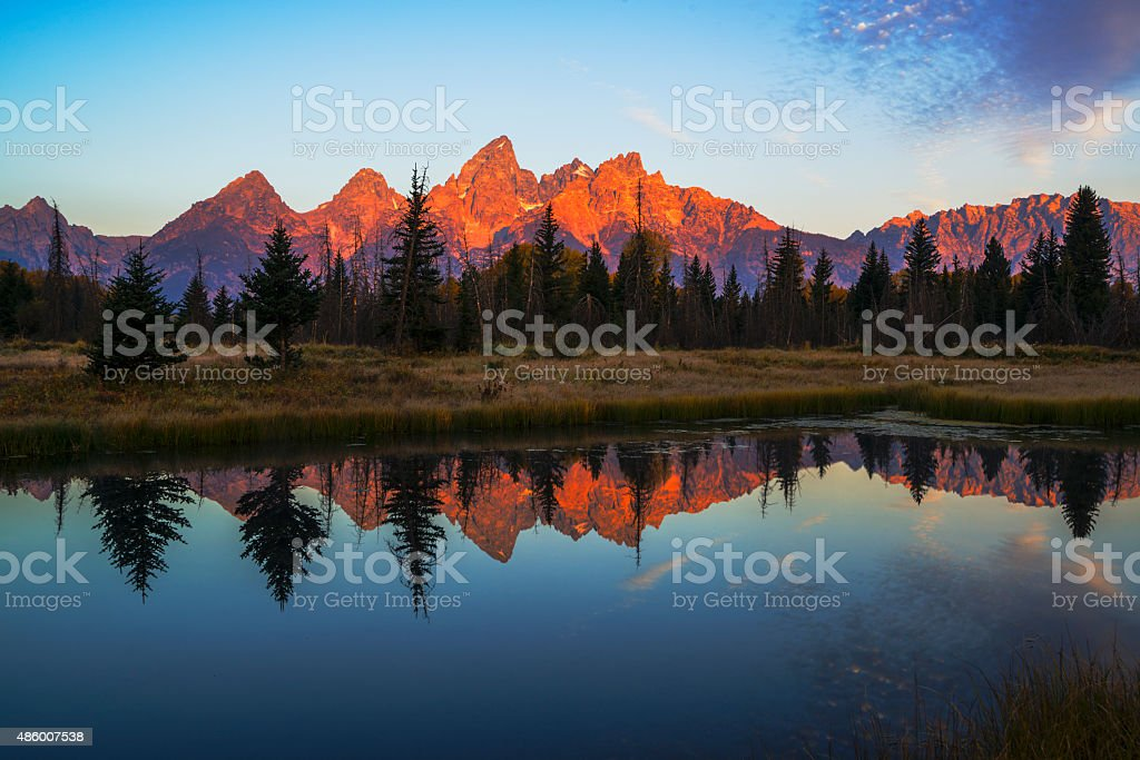 First light illuminating Tetons mountain range stock photo