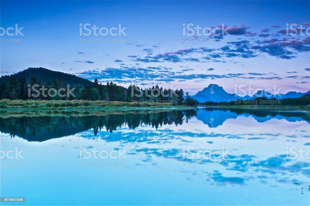 First light illuminating Tetons mountain range stock photo