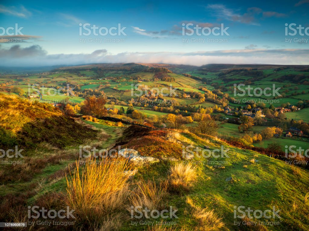 First light of a new day over Rosedale in Autumn. stock photo
