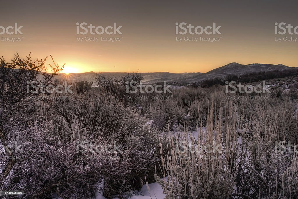 First Light of Sunrise on a snow covered desert royalty-free stock photo