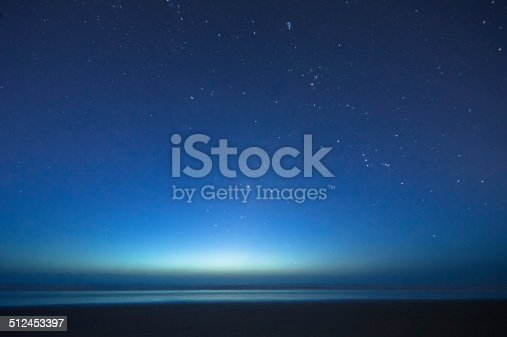 One of a series of photos taken from the beach from the very first sign of light through the actual sunrise.