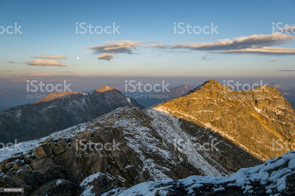 First Light on Colorado Mountains stock photo