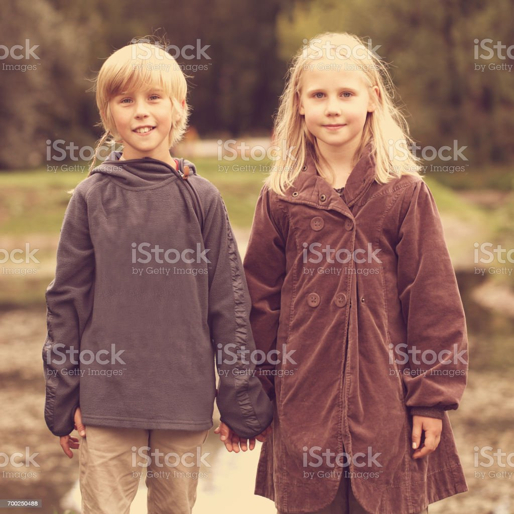 First Love Romantic Concept Little Boy And Girl Holding Hands Stock