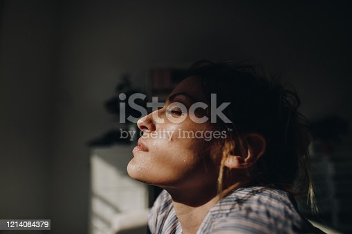 Photo of a young woman coping with loneliness and isolation during CoVid 19 outbreak