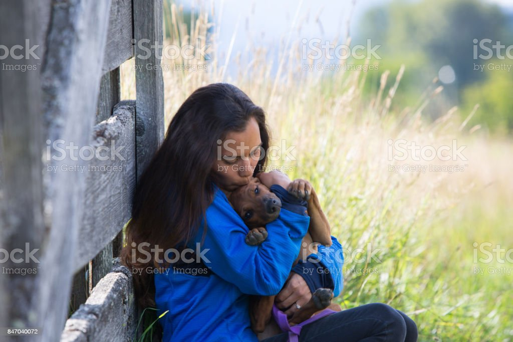 First Nation Canadian woman plays with her pet dog stock photo