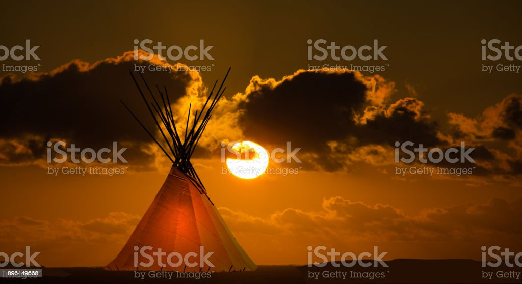 First nation teepee and autumn sunset stock photo