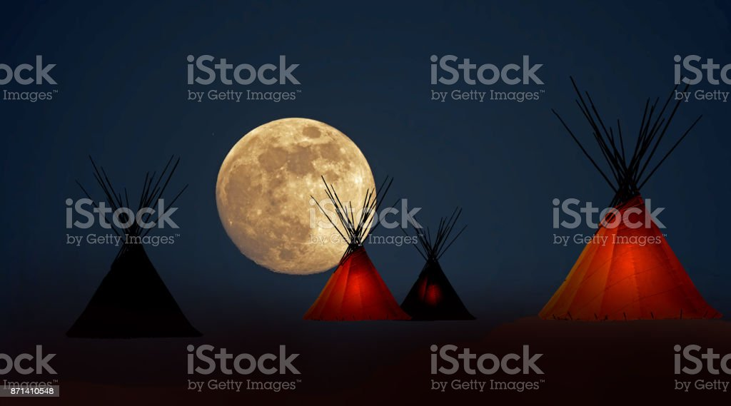 First Nation teepee camp under full moon stock photo