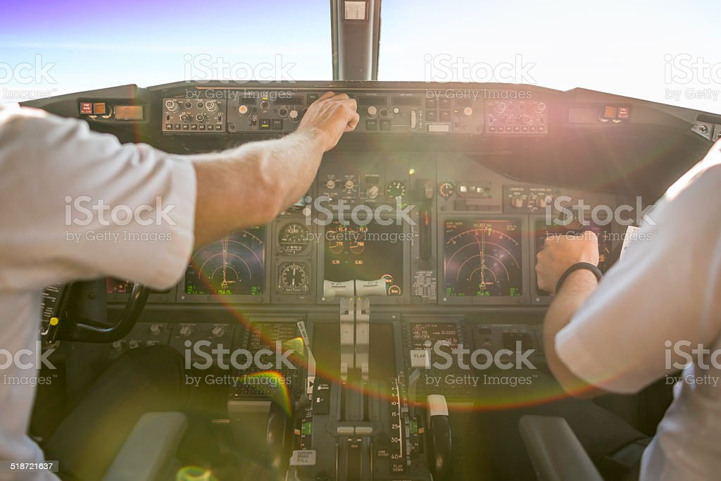 First officer piloting an aircraft stock photo