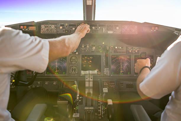 First officer piloting an aircraft stock photo