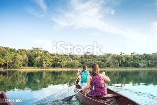 POV of Eurasian sisters paddling in Punta Laguna Nature Reserve, Tulum, Yucatan Peninsula, Quintana Roo, Mexico