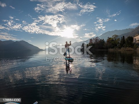 istock First person point of view of a woman paddling on a stand up paddle board 1288844330