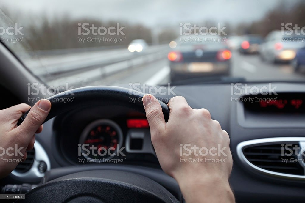 First person point of view of driving a car in traffic stock photo