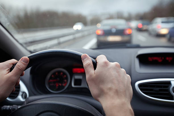 first person point of view of driving a car in traffic - distant stock photos and pictures