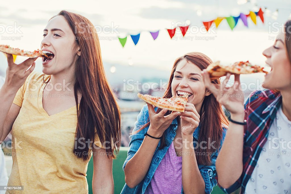 First pizza bite stock photo