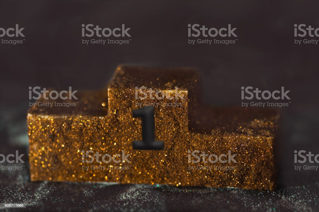first place podium gold stock photo