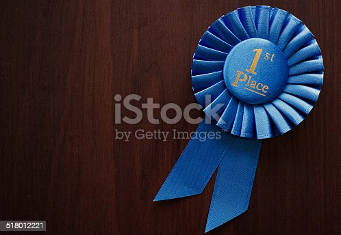 istock First place winners rosette 518012221