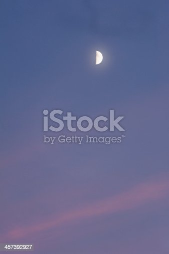 first quarter phase of the moon at beautiful sunset