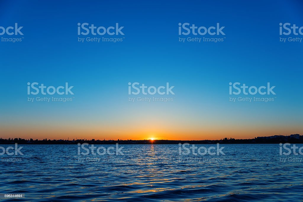 first ray over river in sunrise royalty-free stock photo