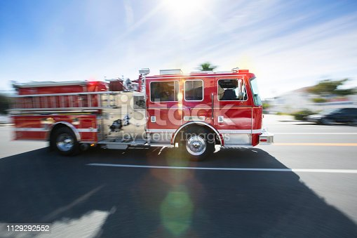 A firetruck races to the scene of an accident.