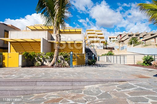 Tenerife, Spain / November 2018. First row yellow facade beach holiday houses in sunny El Médano on the island of Tenerife. El Médano (Spanish,
