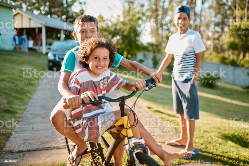 First rule of brotherhood: Ride a bike together stock photo