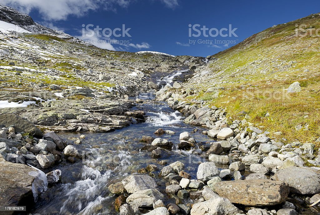 First snow of the season in autumn colored high mountains royalty-free stock photo