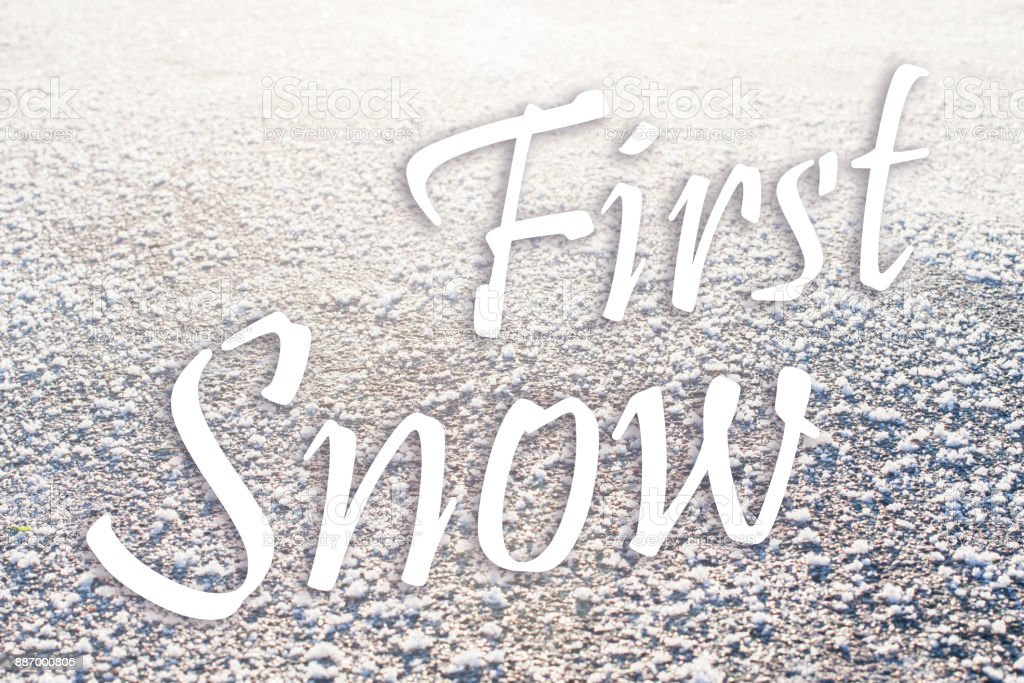 First snow text on background stock photo